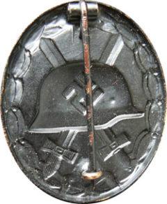 Аверс и реверс знака «За ранение» (черный).