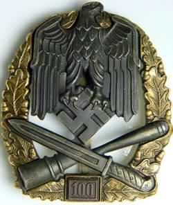 Аверс и реверс знака «За участие в общих штурмовых атаках» 100 атак.