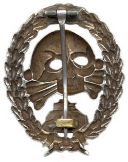 Аверс и реверс знака бронетанкового легиона «Кондор»