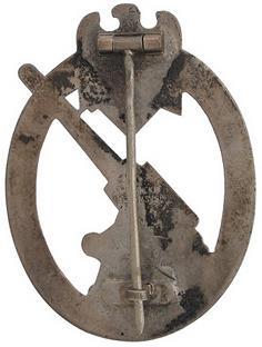 Аверс и реверс знака «Сухопутная зенитная артиллерия»