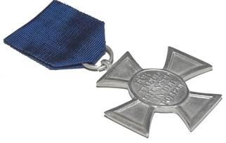 Реверс медали за 18 лет выслуги.