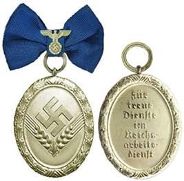 Аверс и реверс медали 18 лет выслуги для женщин.