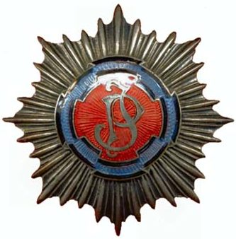 Аверс и реверс офицерского полкового знака 1-го полка легкой кавалерии им. Юзефа Пилсудского.