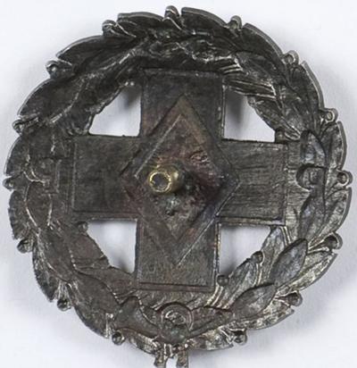 Аверс и реверс солдатского полкового знака 53-го пехотного полка.