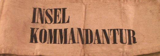 Нарукавная повязка командира оккупационных войск острова.