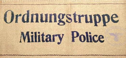 Нарукавная повязка военной полиции.