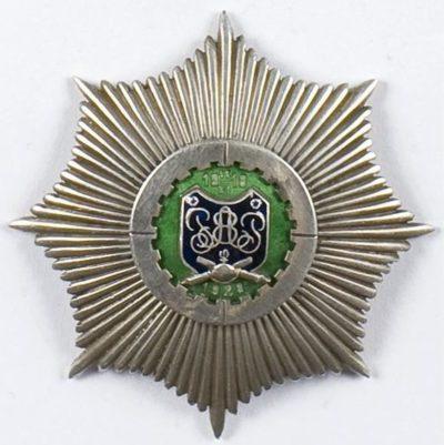 Аверс и реверс полкового знака 8-го Плоцкого полка легкой артиллерии им. короля Болеслава Кривоустого.