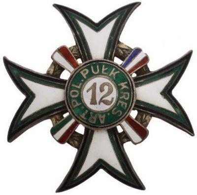 Аверс и реверс полкового знака 12-й пограничного полка легкой артиллерии.