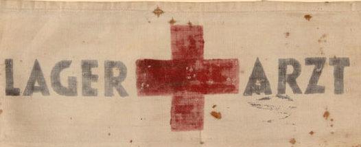 Нарукавная повязка еврейского медика в лагере.