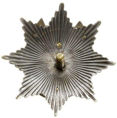 Аверс и реверс офицерского полкового знака 19-го Волынского уланского полка им. генерала Эдмунда Ружицкого.