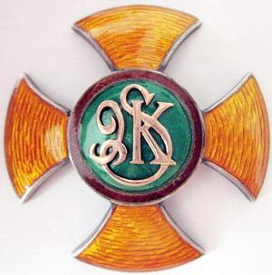 Аверс и реверс офицерского полкового знака 9-го полка конных стрелков им. генерала Казимира Пулаского.
