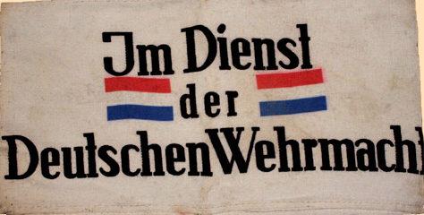 Нарукавная повязка голландского гражданина на службе немецкого Вермахта.