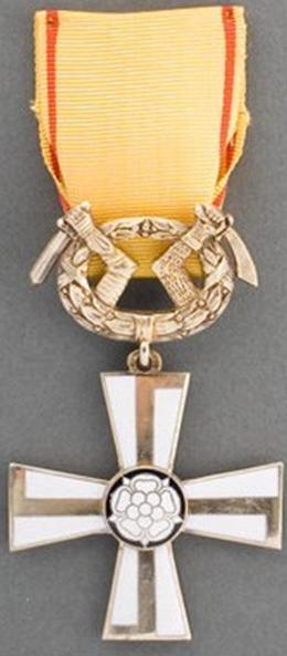 Крест 2-го класса ордена Креста Свободы за военные заслуги в мирное время.