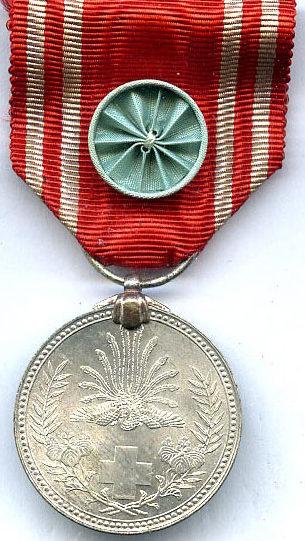 Аверс и реверс Серебряной медали Особого члена Общества.