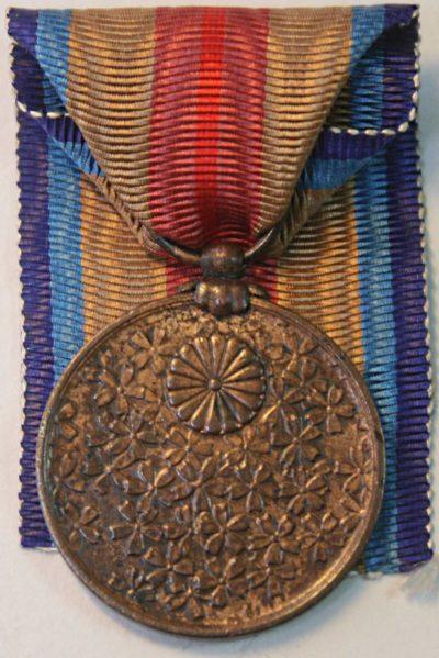 Аверс и реверс медали «В память Китайского инцидента».