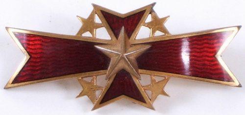 Аверс и реверс знака «За военные заслуги».
