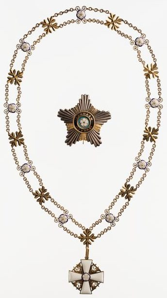 Большой крест ордена Белой розы Финляндии на цепи нового образца (со снежинкой).