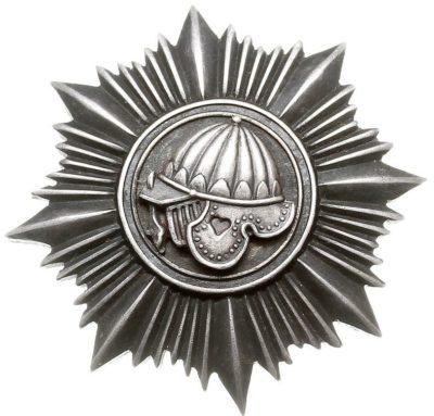 Аверс и реверс памятного знака 5-го танкового батальона.