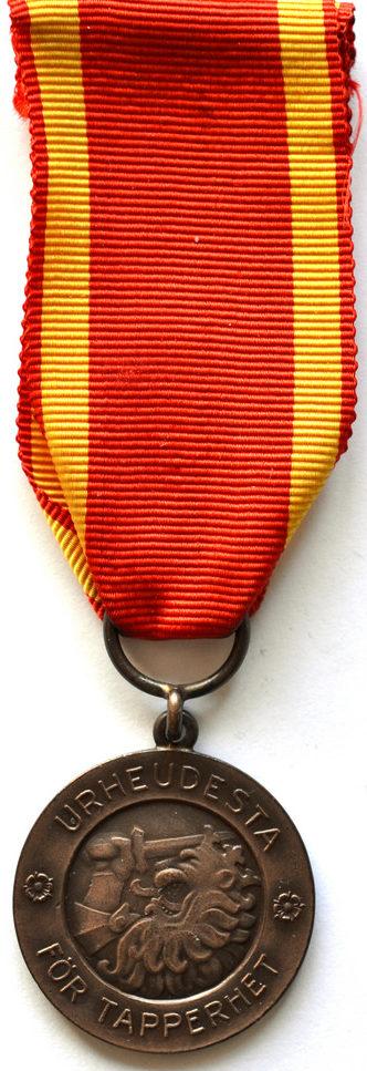 Аверс и реверс медали Свободы 2-го класса ордена Креста Свободы.