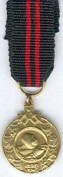 Аверс и реверс золотой медали «За зимнюю войну» для иностранцев.