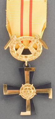 Крест 3-го класса ордена Креста Свободы за военные заслуги в мирное время.