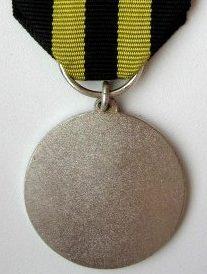 Аверс и реверс медали гражданской обороны «За заслуги» 1-й степени.