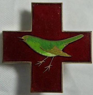 Аверс и реверс Креста Найтингейл. Вручался сотрудникам Красного Креста в память о его основателе в Японии.