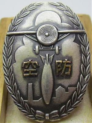 Аверс и реверс памятного знака о манёврах ПВО в Таками в 1934 г.