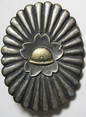 Аверс и реверс памятного знака о маневрах 4-й группы ПВО округа Nihon-bashi в 1935 г.