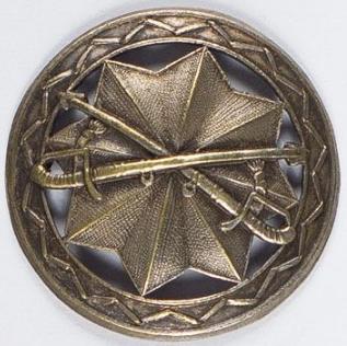 Аверс и реверс памятного знака школы офицеров боевой ассоциации «Парасоль».