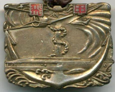 Аверс и реверс памятного жетона 3-го выпуска кадетов в 1940 году.