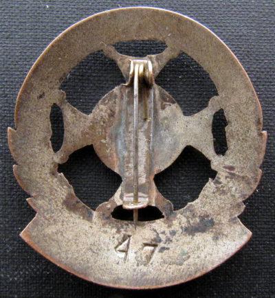 Аверс и реверс памятного знака подпольной группы «Радослав».