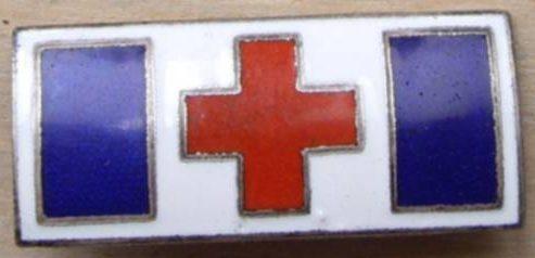 Аверс и реверс знака санитарной службы организации «Lotta Svärd».