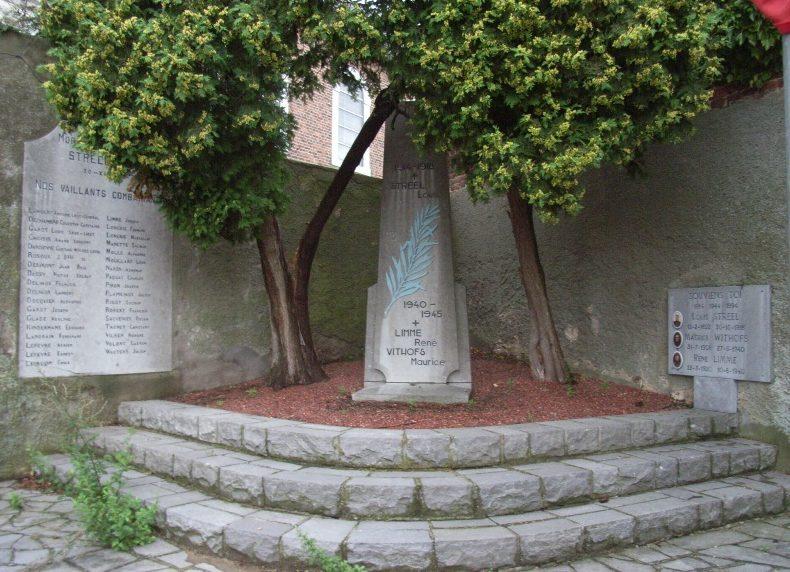 Коммуна Avernas-le-bauduin. Памятник погибшим в обеих войнах у церковных стен.