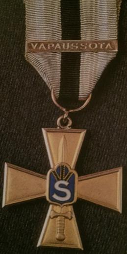 Золотой крест Шюцкора «За заслуги».
