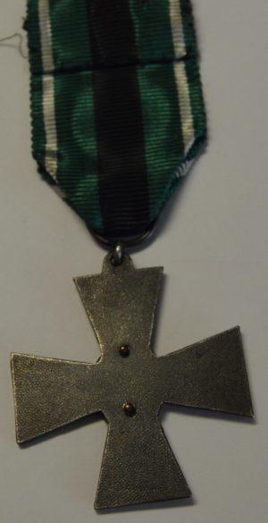 Аверс и реверс бронзового крест Шюцкора «За заслуги».