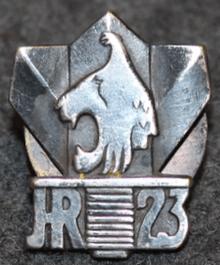 Аверс и реверс знака 23-го пехотного полка.