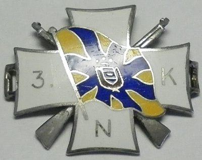 Аверс и реверс знака Северного полка.