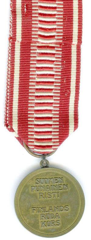 Аверс и реверс бронзовой медали «За заслуги» Финского Красного Креста.
