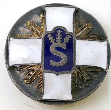 Знак «За достижения» Шюцкора высшей степени.