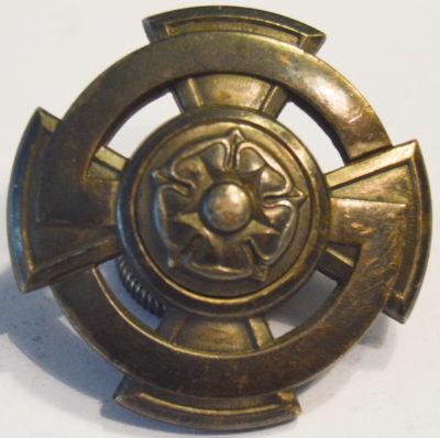 Аверс и реверс знака «За заслуги» Шюцкора 3-го класса.