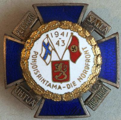 Крест Лапландского фронта с белой эмалью и датой «1941-43» в верхней части.