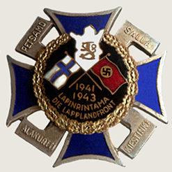 Крест Лапландского фронта с черной эмалью и датой «1941-1943» в нижней части.