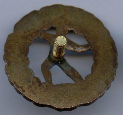 Аверс и реверс знака Шюцкора « За метание гранаты 3-й класс».
