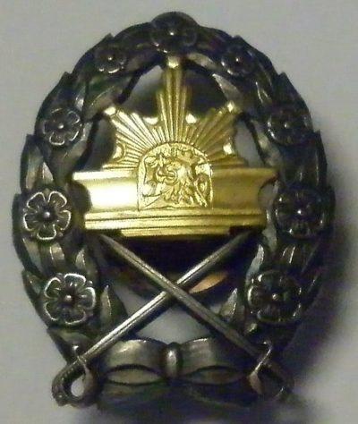 Аверс и реверс знака выпускника школы кадетов.
