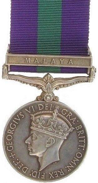 Аверс медали «За участия в военных кампаниях» с изображением короля Геррга VI. (1936-1952 гг.).