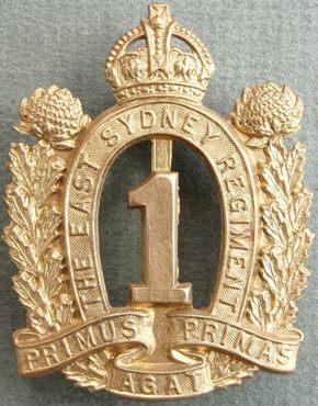 Аверс и реверс знака на шляпу военнослужащих 1-го пехотного батальона.