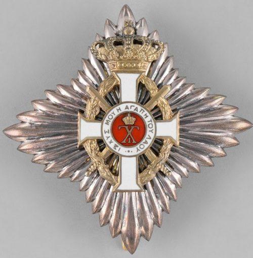 Аверс и реверс Звезды Большого командорского креста с мечами.