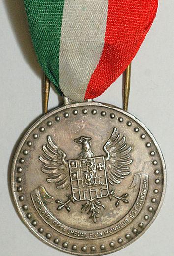 Знак памятной медали 4-го Генуэзского кавалерийского полка.