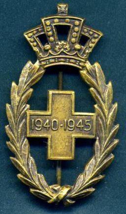 Аверс и реверс знака участника войны 1940-1945 годов.